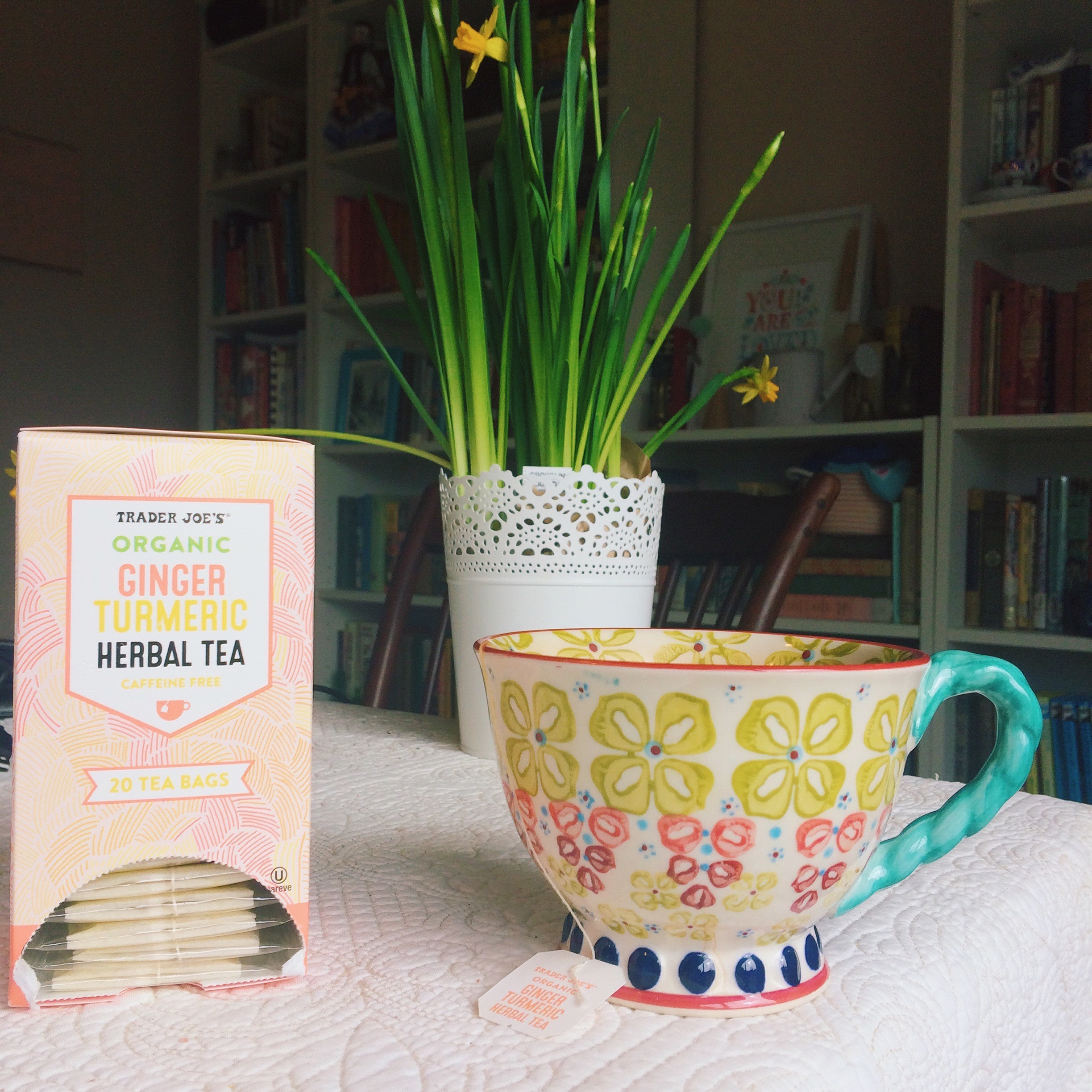 Trader Joe's Ginger Turmeric Tea and tete-a-tete narcissus and teacup