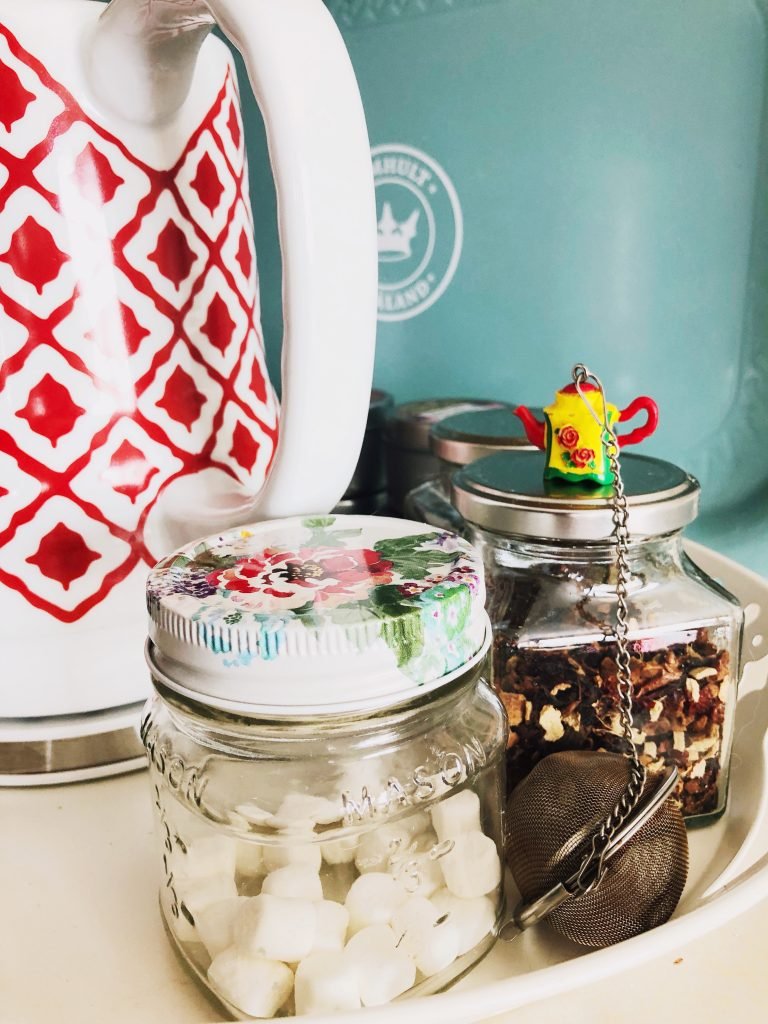Tea station and jar of marshmallows with strainer